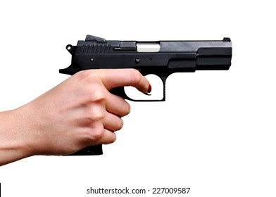 Black gun in a hand on the white background. Isolated on white