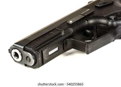 The black gun (pistol) on a white background close up. Isolate