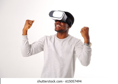 Black guy with virtual reality glasses isolated on white