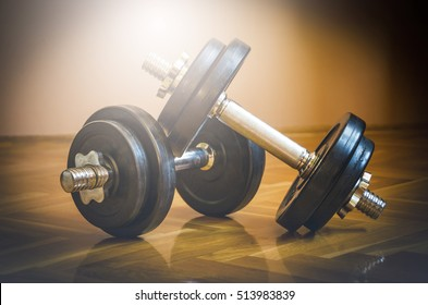 Black gym barbell, dumbbell with disks