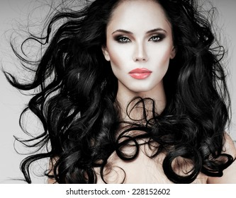 Black Hair. Fashion Girl Portrait. long  Hair and red lipstick.