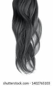 Black hair isolated on white background. Long wavy ponytail