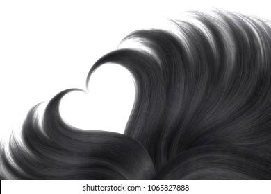 Black hair in shape of heart on white