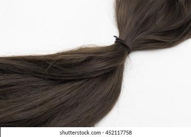 black hair tied on white background