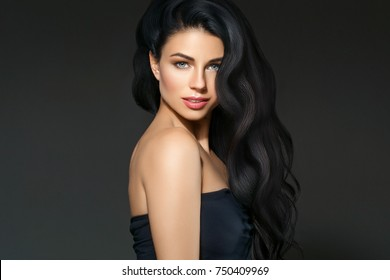 Black hair woman. Beautiful brunette hairstyle fashion portrait with beauty long black hair over dark background