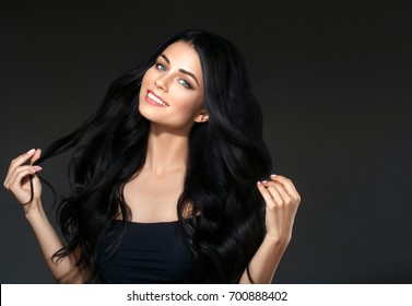 Black hair woman beautiful portrait. Hairstyle curly hair beauty female model girl over dark background