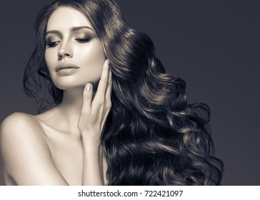 Black hair woman beautiful portrait. Hairstyle curly hair beauty female model girl black and white
