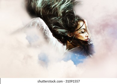 black hair woman with flying hair in the clouds