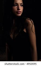 black hair woman portrait, studio shot