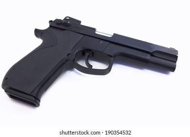 Black hand gun isolated on black