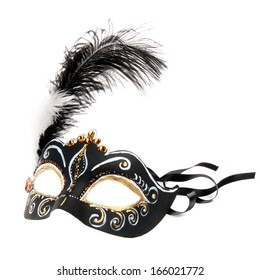 Black hand painted  Venice mask with feathers isolated on a white background