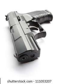 Black handgun isolated on a white background