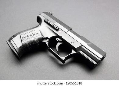 Black handgun on a black background