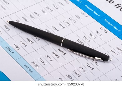 The black handle lays on financial statement