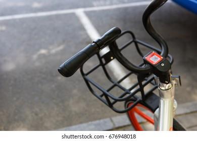 A black handlebar of a bicycle.