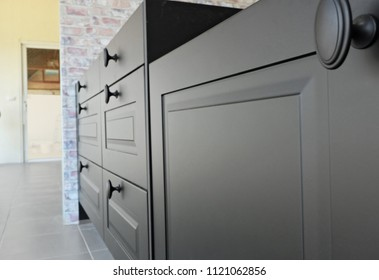 Black handles vintage style on black kitchen wooden cabinets