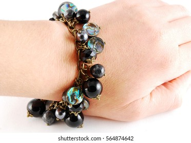 Black handmade bracelet on white background