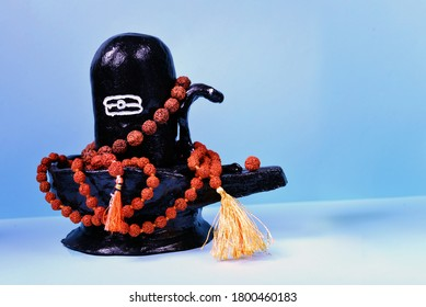 Black handmade Shiva Lingam figure with rudraksha beads