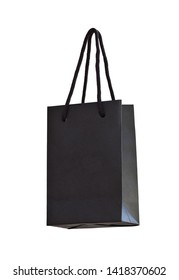 Black hanging paper shopping bag on white. Bottom view, isolated on white