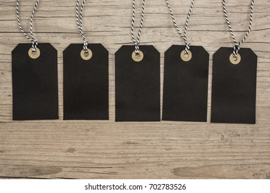 Black hanging tags with copy space close up