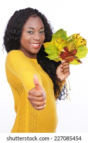 Black happy woman with colorful leaves