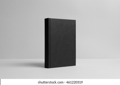 Black Hardcover Book Mock-Up - Wall Background