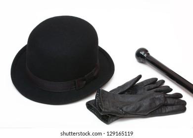 Black hat, gloves and cane