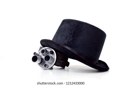 black hat and old movie camera on white background