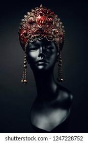 Black head of mannequin in creative in red  headwear