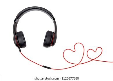 Black headphones with heart-shaped wires on white background
