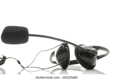 Black headphones with microphone isolated over white background. Empty space ready for your text.