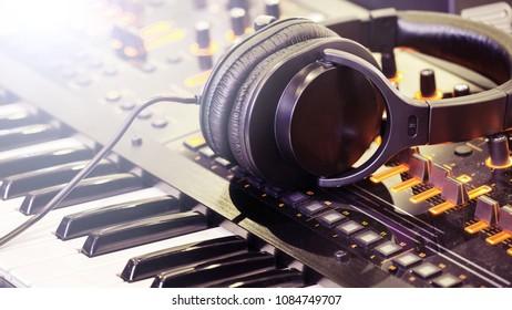 Black Headphones on synthesizer keyboard.