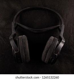 Black Headphones over black background, square image