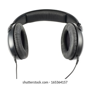 Black headphones set with a wire, isolated over white background