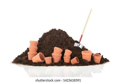 Black heap sand with shovel isolated on white background