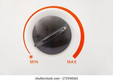 Black heater control knob. With red scale minimum or maximum