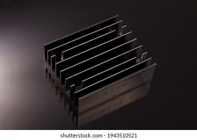 Black heatsink for high power electronics cooling made from aluminium profile isolated on the black background