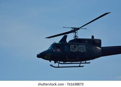 black helicopter on sky