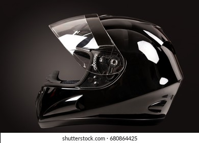 Black helmet isolated in a dark background
