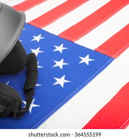 Black helmet over US flag as symbol of active life style - studio shot