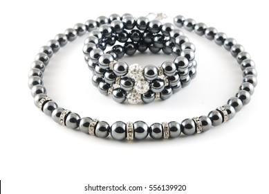 Black hematite handmade set on white background