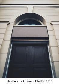 Black historical building Door with entrance singboard mockup