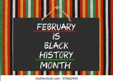 Black History Month Blackboard hanging on striped background