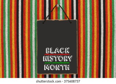 Black History Month Blackboard hanging on Striped Pattern Background