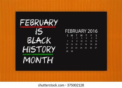 Black History Month February 2016 Calendar Blackboard hanging on orange textured background
