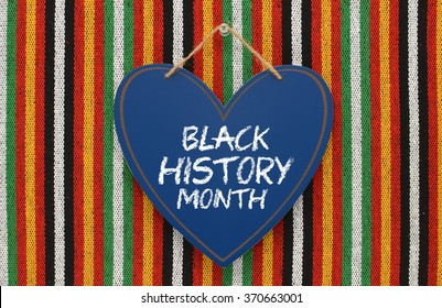 Black History Month Heart Chalk board Sign Hanging on Colorful Striped Background