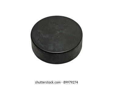 Black hockey puck isolated on white background