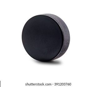 A black hockey puck in upright position isolated on white background with copy space.