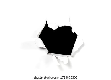 A black hole in white paper. Broken white paper. hole to nowhere