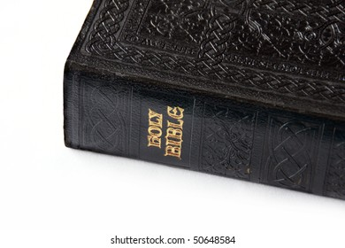 Black Holy Bible with gold lettering.